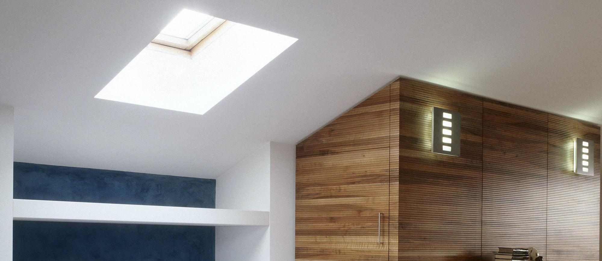 Skylights in the ceiling of a spacious modern living room.