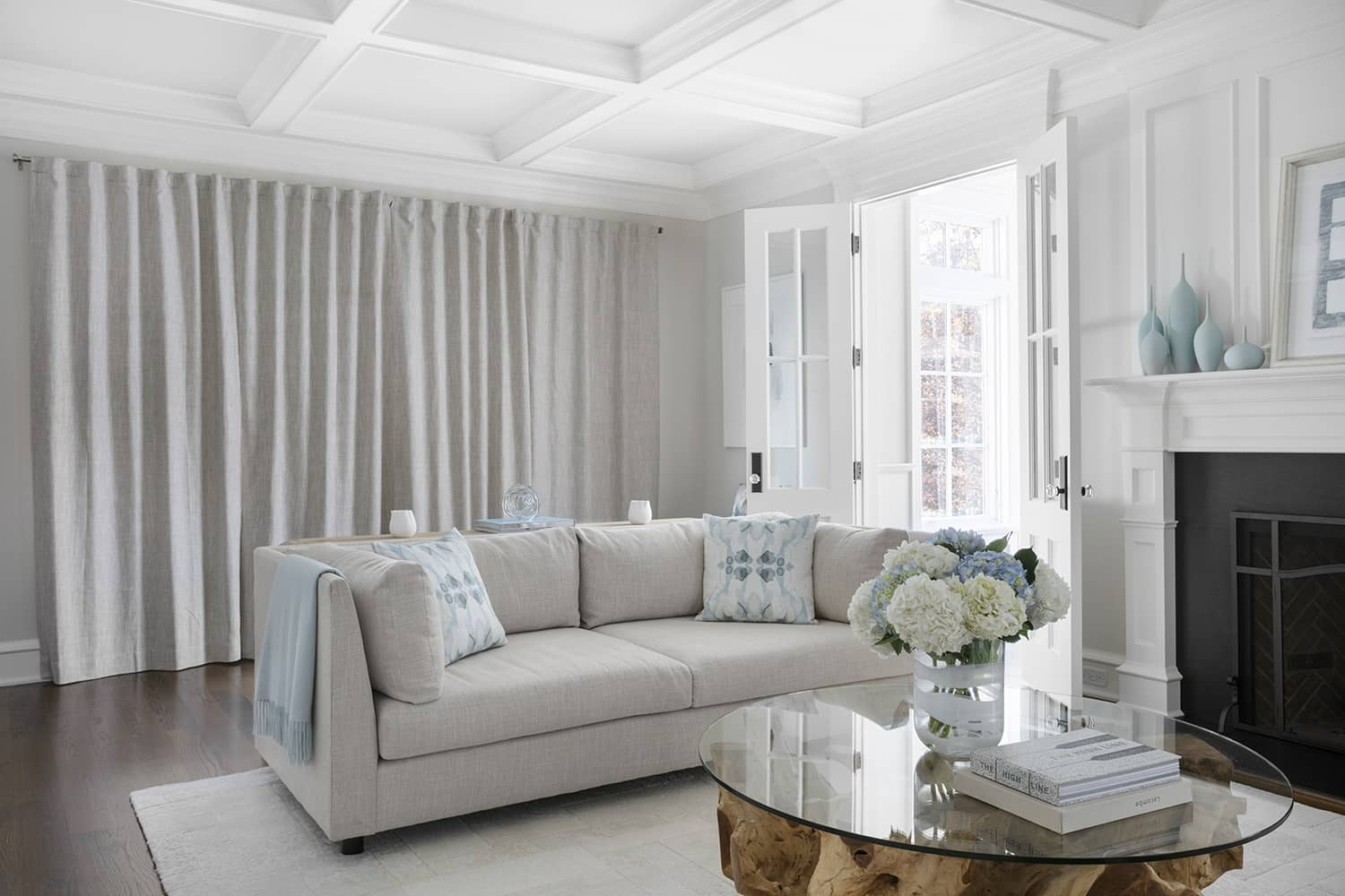 Modern living room showcasing drapery with blackout liner.