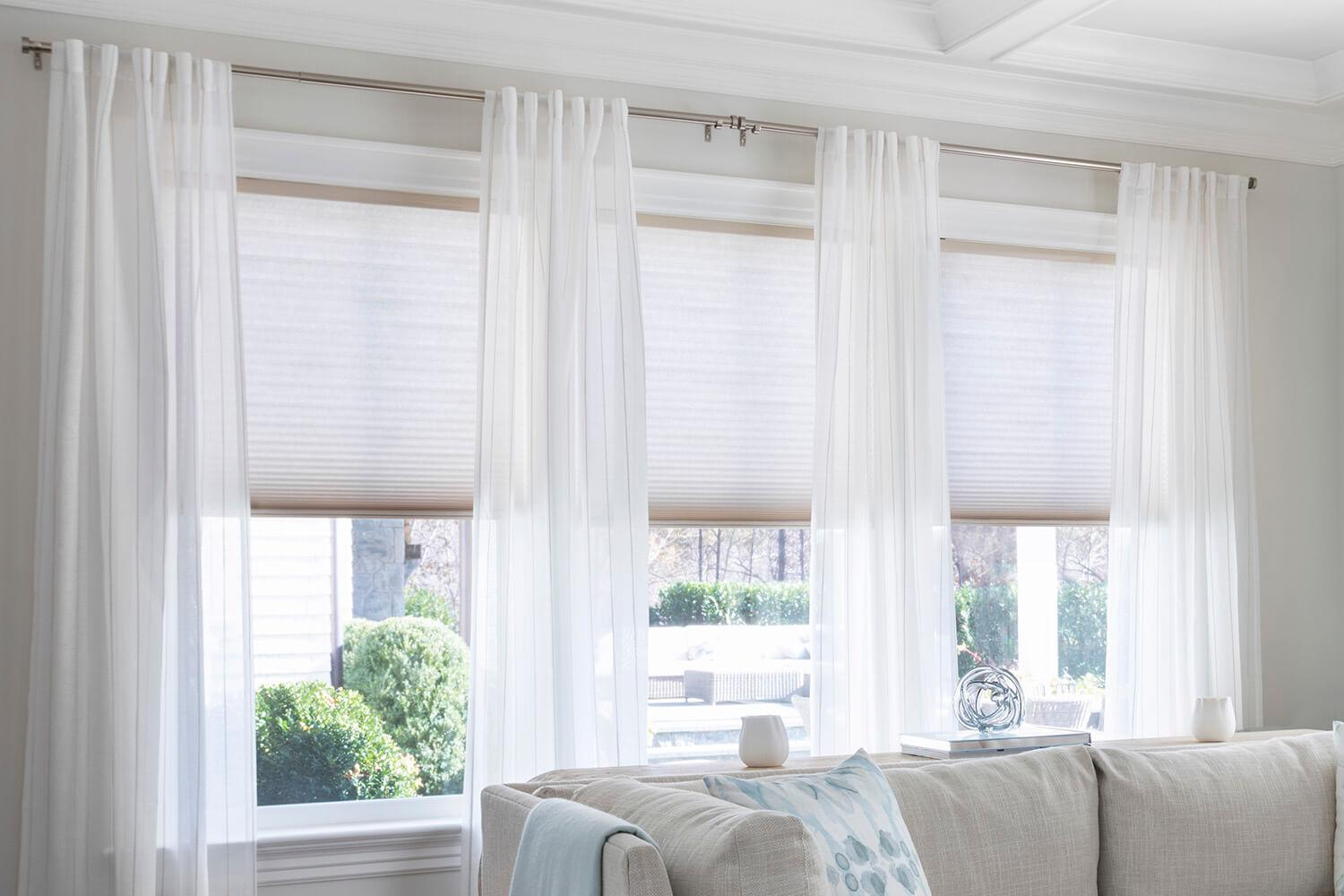 Showcasing drapery in combination with cascade shades.