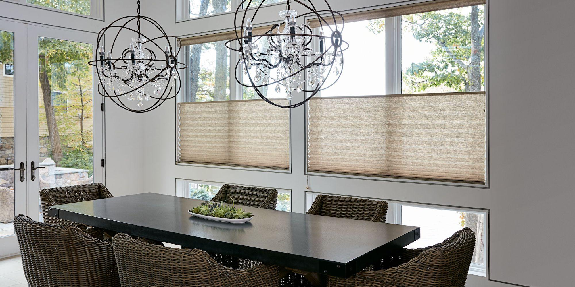 A dining room features large windows with top-down bottom-up pleated shades