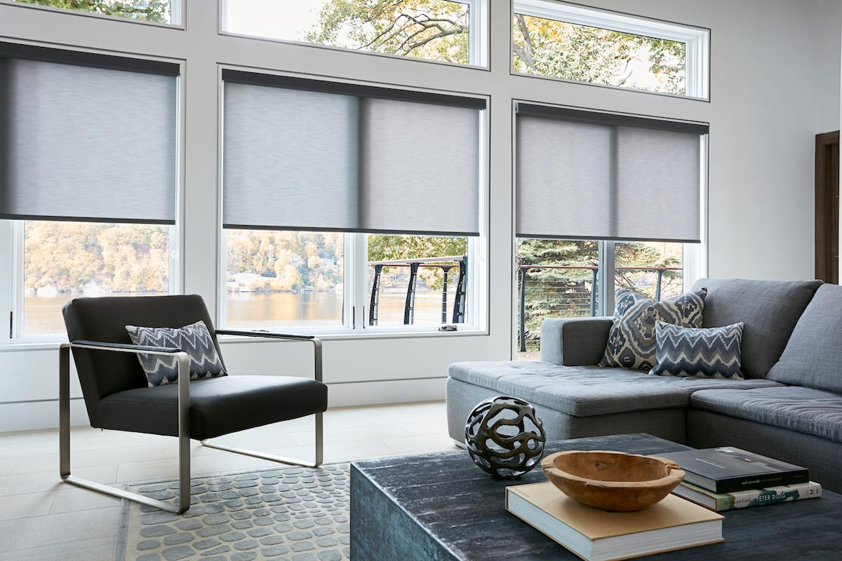Light grey roller shades in a modern living room