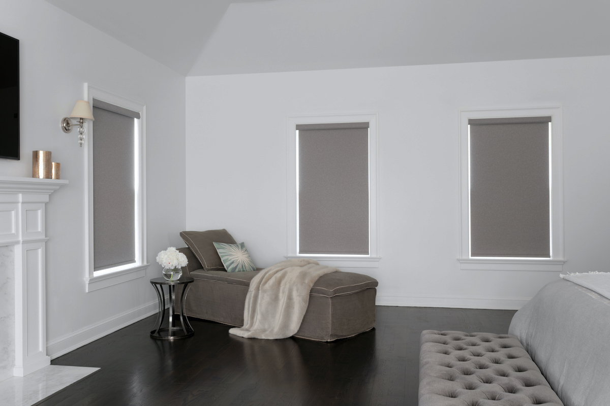 Blackout roller shades in a spacious bedroom