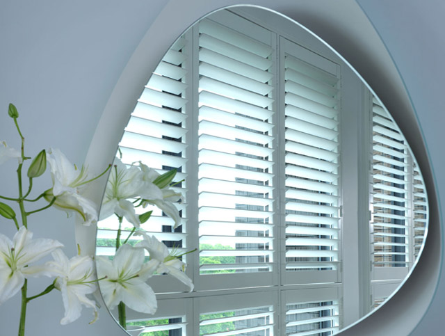 Ideal shutters reflected in a mirror