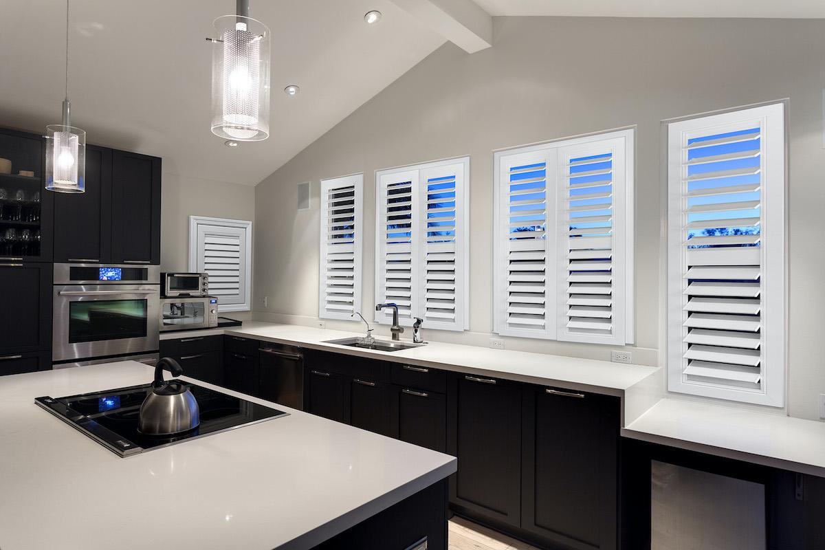 White indoor shutters in a large contemporary kitchen