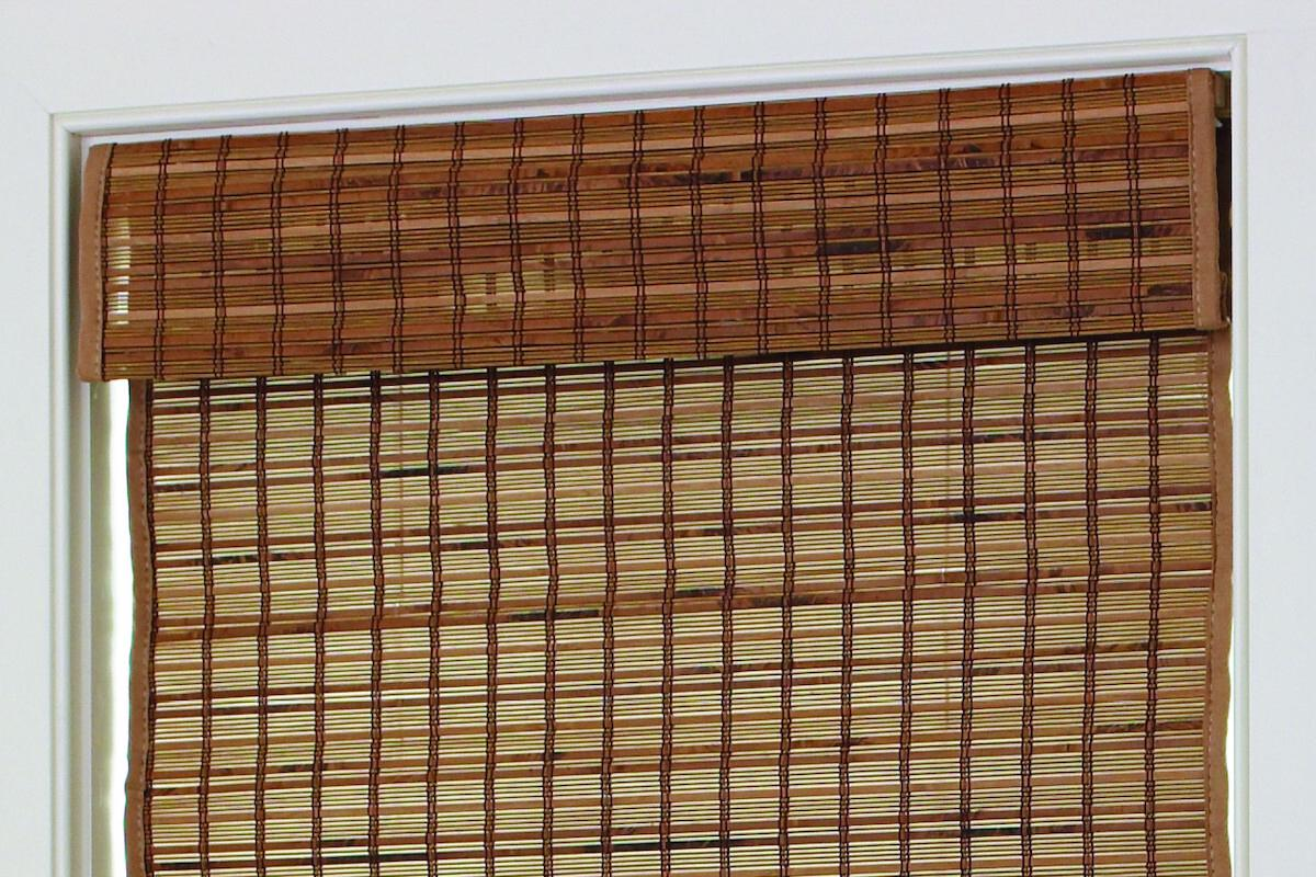 A close up of the casual valance on a woven wood shade made of reeds and bamboo in alternating rows